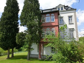 Holiday apartment with a conservatory and villa park in the beautiful Ore Mount