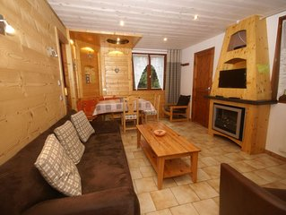 wooden chalet, skiing in the winter season