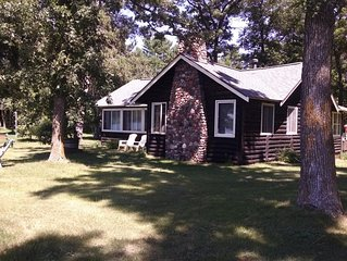 Charming Cabin with Beautiful Spooner Lake Front