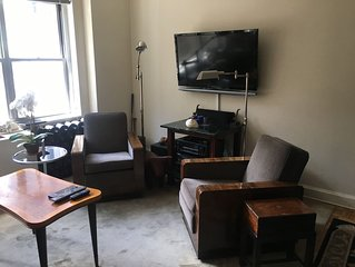 Upscale, large, high-ceilings, mid-town doorman NYC apartment centrally located
