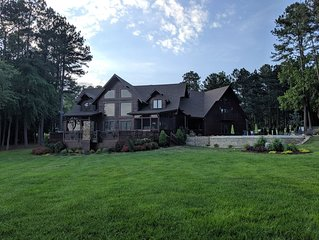 Gorgeous log home with amazing waterfront, private beach, new pool & boat avail.