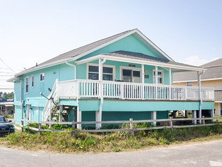 Rock your worries away on the expansive deck at your classic beach cottage