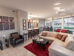 Breathtaking Ground-Floor Waterfront 2BR/2BA Luxury Condo