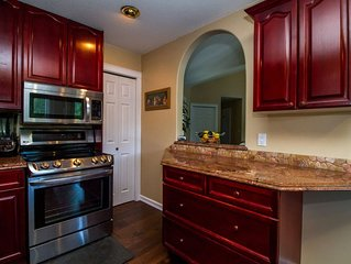 3 bed 3 bath Executive Home nestled privately  right on the Columbia River