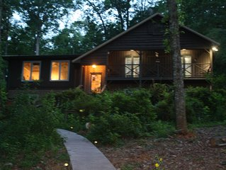 Lake Keowee lakefront 4 bedroom 3 bath home with dock, patio and fire pit.