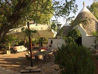 Charming trulli in beautiful garden