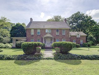 Elegant, spacious, circa 1925 brick home in a private setting