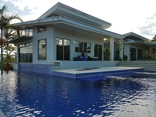 Pool is 'L shaped', surrounding the master living room