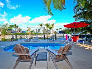 GREAT LOCATION!! Walk to everything! Private HTD Pool & Boat Dock! Beachy Decor