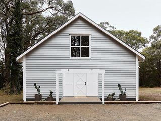 The Red Hill Barn is a boutique accommodation nestled within the gum trees.