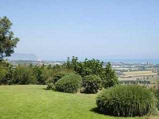 Villa on a hill overlooking the sea