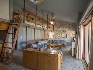 An architect's masonry house,Anavyssos, Attica, with view to Aghios Nikolaos be