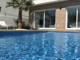 Contemporary new villa with private swimming pool and close to beaches