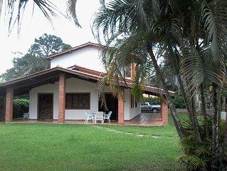 Casa de praia cercada de natureza