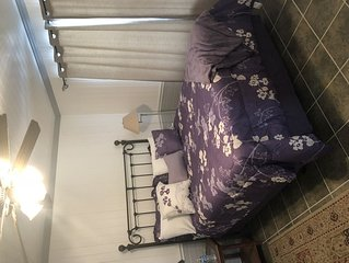 Queen Suite - a nice bedroom, private bath and a sitting room with an easy chair