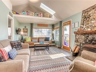 This adorable historic cottage with a rock chimney, only ½ block from the beach