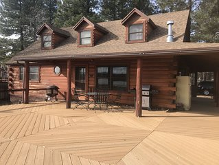 Family Friendly Lakefront Cedar Log Cabin on 2 acres at Rainbow Lake.