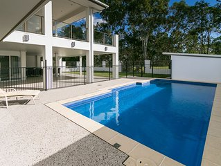 Huge, Modern, Waterfront home with Air con & pool!