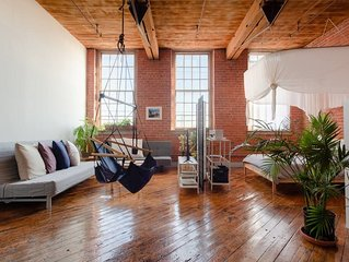 Bright, Creative Loft on the River Near Downtown