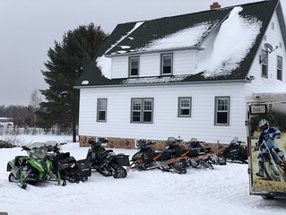 Snowmobile heaven.  Ride to trails and 80 acres of fields on property.