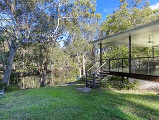 Your own stretch  of wilderness river only 15 mins from Hastings St, incl kayaks