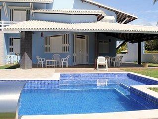 Casa com 4 quartos frente ao mar (pe na areia) em Guarajuba