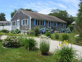 Comfortable Coastal Cottage surrounded by flowers gardens 3 min. from Town Beach