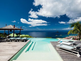 Outstanding Ocean Views, T-Shape Infinity-Edge Pool, Swim-up Bar beneath a Charm