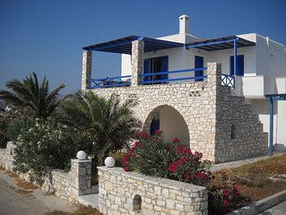 Traditional Cycladic house with view to the deep blue
