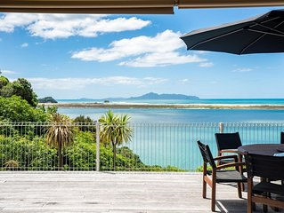 Three bedroom cottage in secluded setting with stunning estuary and ocean views.