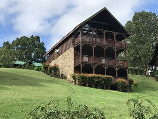 Premier family friendly cabin, fireplace, hot tub and 3 video game consoles