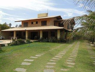 Excelente casa de praia com vista para o mar, piscina com cascata e terraco