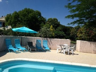 2 bedroom gite with aircon, large garden and swimming pool - near beaches.