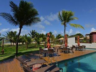 Vilage pé na areia com piscinas naturais próximas ao condomínio!