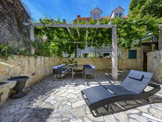 Charming house with beautiful large garden inside ancient city walls