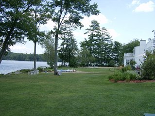 Modern lakefront home on Lake Waukewan with spectacular fall folliage views!