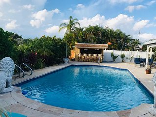 New on the market! Renovated 3BR/2BA with large heated saltwater pool & tiki bar