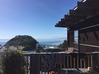 Beautiful modern bach overlooking surf beach