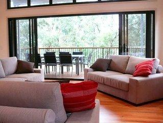 Warrawee: lakefront house