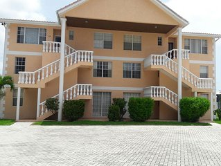 WATERFRONT AND BEACH ACCESS EXECUTIVE CONDO WITH BOAT SLIP