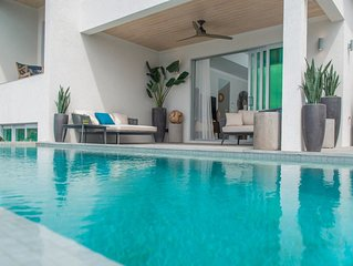 Luxury villa with infinity edge pool, ocean views and private-access beach