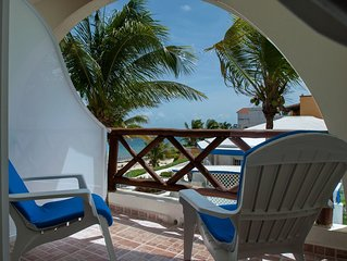 Fabulous beach front 'Blue' studio with AC on 2 levels