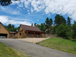 OFF THE LOOP is a charming rural home in the heart of the northern Black Hills