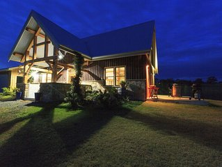 Luxury off-grid home with wood fire oven. Pet & family friendly, set on 3 acres.