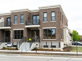 Affordable luxury in a brand new Row House Condo just steps from all things GH!