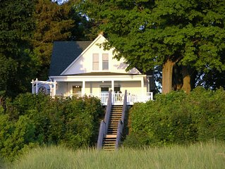 THIS IS IT!  Cozy Cottage on private beach only a mile from downtown South Haven