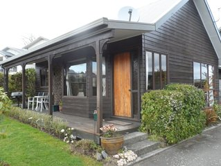 Taupo home in garden setting by lake.