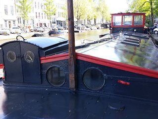 whole houseboat to rent in central jordaan area of amsterdam