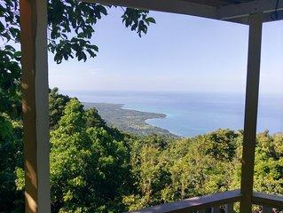 Treehouse style cabin overlooking Caribbean ocean.