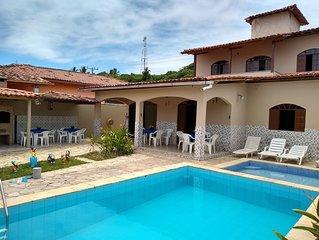 Casa com Ar Condicionado, duas piscinas, banheira, churrasqueira, 15 pessoas